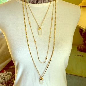 Three strand gold and Crystal necklace
